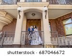 groom with the bride near the... | Shutterstock . vector #687046672