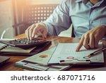 businessman calculating... | Shutterstock . vector #687071716