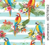 tropical flowers and parrot... | Shutterstock .eps vector #687078562