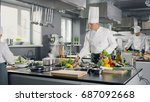 famous chef works in a big... | Shutterstock . vector #687092668