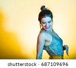 beautiful woman dancing and... | Shutterstock . vector #687109696