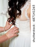 the bride getting her dress...   Shutterstock . vector #687141265