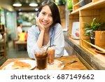 woman enjoy her food in coffee... | Shutterstock . vector #687149662