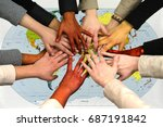 stack of hands over world  map | Shutterstock . vector #687191842