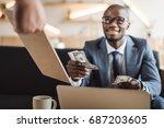 handsome african american... | Shutterstock . vector #687203605