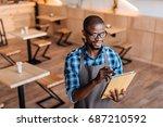 handsome smiling african... | Shutterstock . vector #687210592