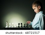 Little Serious Boy Plays Chess
