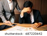 depressed business person. | Shutterstock . vector #687220642
