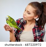 parrot sitting on a girls hand... | Shutterstock . vector #687220972
