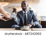 handsome smiling african... | Shutterstock . vector #687242002