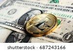 litecoin on one dollar banknote | Shutterstock . vector #687243166
