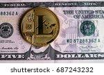 litecoin on five  dollar... | Shutterstock . vector #687243232