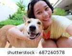 Stock photo asian woman selfie with dog 687260578