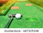 Golf Ball And Golf Club On...