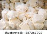 meringue. pile of meringues in... | Shutterstock . vector #687361702