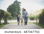 Stock photo asian father and son walking with a siberian husky dog in the park 687367702