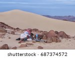 bedouin man laying on the sand... | Shutterstock . vector #687374572