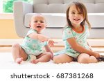 toddler sisters fighting over a ... | Shutterstock . vector #687381268