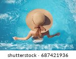 back view of woman in straw hat ... | Shutterstock . vector #687421936