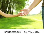 the parent holds the hand of a... | Shutterstock . vector #687422182