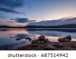 sunset over a mountain lake in... | Shutterstock . vector #687514942