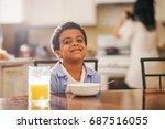 cute little mixed race boy... | Shutterstock . vector #687516055