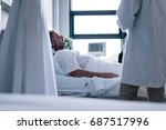 sick man lying in hospital bed... | Shutterstock . vector #687517996