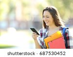 single happy student holding...   Shutterstock . vector #687530452