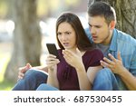 angry couple using a smart... | Shutterstock . vector #687530455