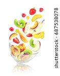 flying fruit salad in glass... | Shutterstock . vector #687538078