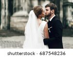 groom holds bride's back tender ... | Shutterstock . vector #687548236