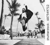 happy groom jumps on the way... | Shutterstock . vector #687549712