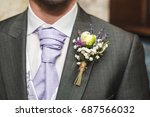 boutonniere on the suit jacket... | Shutterstock . vector #687566032