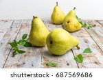 fresh organic pears on old wood.... | Shutterstock . vector #687569686
