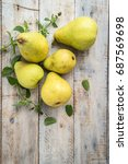 fresh organic pears on old wood....   Shutterstock . vector #687569698