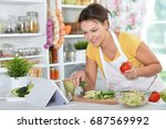 young woman preparing dinner on ... | Shutterstock . vector #687569992