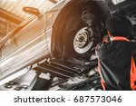 car lifted in automobile... | Shutterstock . vector #687573046