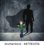 young child with his shadow of... | Shutterstock . vector #687581056