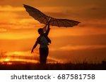 boy launch a kite in the field... | Shutterstock . vector #687581758