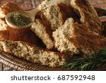 bread with aromatic herbs on... | Shutterstock . vector #687592948
