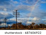 Rainbow And Wires Over Train...
