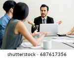 Small photo of Business negotiation, male partners arguing, funny easygoing woman keeping calm in stressing situation, meditating with composed smile, dealing with emotional angry customer, stress management