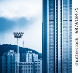 modern skyscrapers against sky... | Shutterstock . vector #687618475