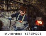 industrial machinist working on ...   Shutterstock . vector #687654376