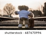 Small photo of Teddy bear carrying his suitcase, saying goodbye, going on vacation, going out into the big, wide world.