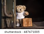 teddy bear with suitcase says... | Shutterstock . vector #687671005