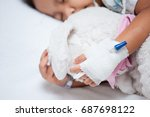 sick child girl's hand with... | Shutterstock . vector #687698122