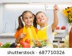 happy children make selfie on... | Shutterstock . vector #687710326