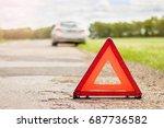 red triangular emergency stop...   Shutterstock . vector #687736582