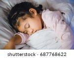 little child girl sleeping in...   Shutterstock . vector #687768622